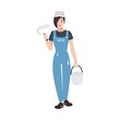 Joyful house painter or decorator wearing dungarees and holding paint roll and bucket. Funny female cartoon character isolated on white background. Colorful vector illustration in flat style.