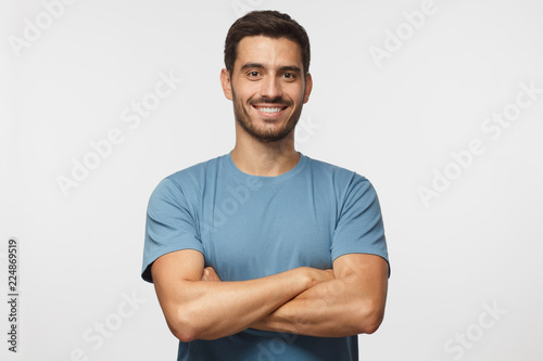 Fotografie, Obraz Indoor portrait of young european caucasian man isolated on gray background, sta