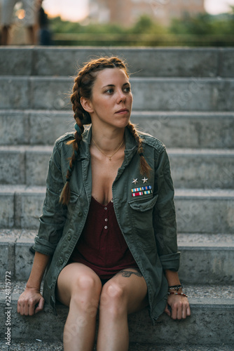 Pretty red-haired girl with braids.
