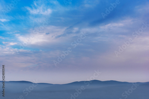 Canvas Prints Light pink Foggy mountains clouds and sky landscape