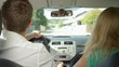 CLOSE UP: Young couple fights in the car while cruising through the sunny suburban neighborhood. Male driver and his girlfriend argue during road trip. Caucasian tourists quarreling during vacation.