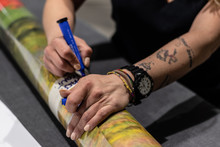 Ex Convincts' Redemption Chance In A Professional  Printing Facility, Big Vinyl Rolls, Ready For Large Printer Supply. Prison Tattoos On Arms And Hands.