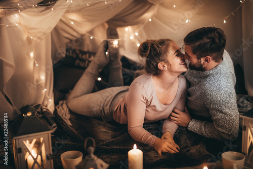 Couple on bed together in romantic mood