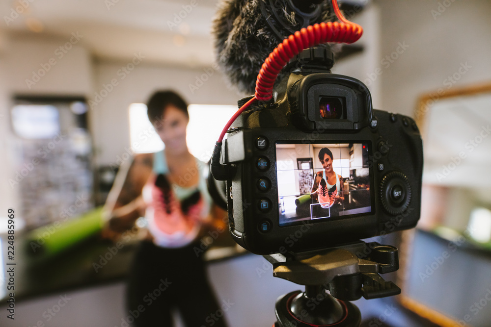 Fototapety, obrazy: Social media influencer recording video for blog