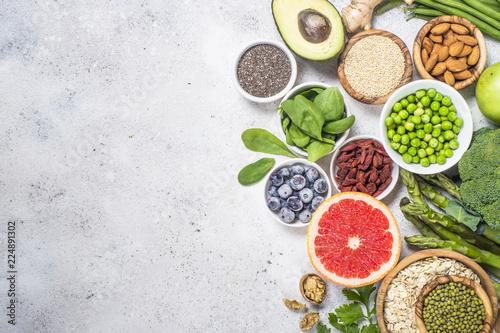 Superfoods on light stone background. Healthy vegan food. Canvas Print