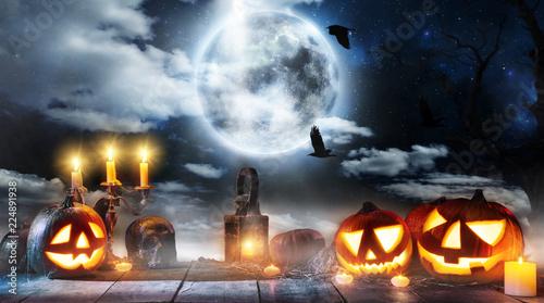 Spooky halloween pumpkin placed on wooden planks