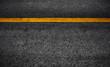 canvas print picture - Yellow paint line on black asphalt. space transportation background