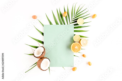 Creative layout made of paper and summer tropical fruits on white background. Food concept. flat lay, top view