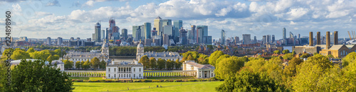 Poster London ondon, England, Panoramic Skyline View Of Greenwich College and Canary Wharf At Golden Hour Sunset With Blue Sky And Clouds