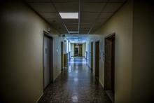 View Of An Abandoned Psychiatric Hospital Corridor