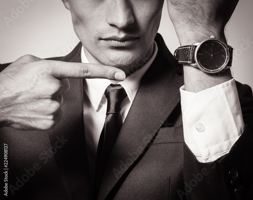 Fotografie, Obraz  Business man showing time on his wrist watch