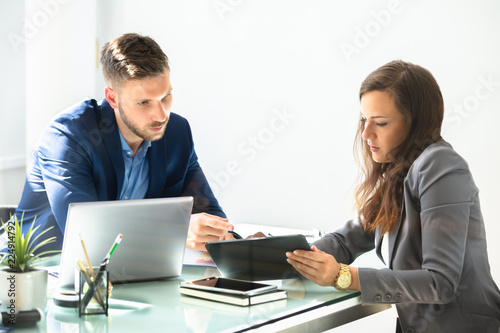 Canvas Two Businesspeople Using Digital Tablet