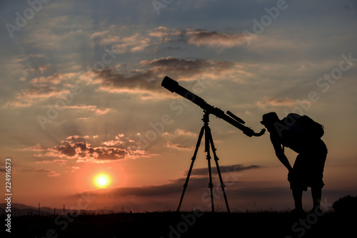 student studying with telescope