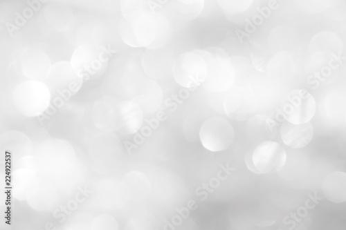 Fototapeta A brilliant blurry white background for a festive mood. Template for greeting card for entertainment. obraz na płótnie