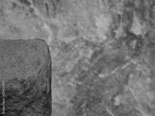 In de dag Stenen A Shaded Corner of a Dirty White Rock Showing a Gritty Texture of the Mineral, Outlined against a Blurred Rough Textured Stone.