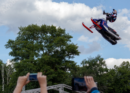 Extreme sports, speed, adrenaline concept. Jumping to the sky, flying among the clouds. People photographing the event..