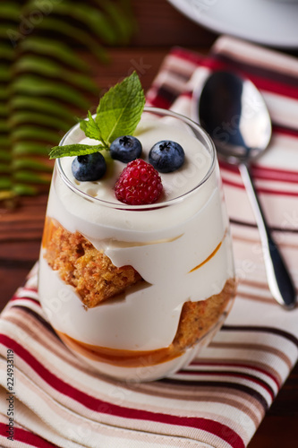 Glass with mascarpone, biscuits, berries dessert