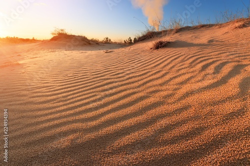 Staande foto Zandwoestijn sunset in the desert / sand dune bright sunset colorful sky