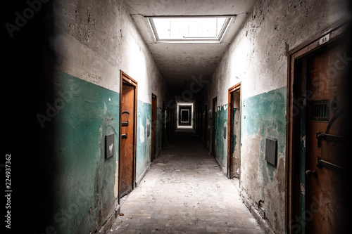 An old corridor of a creepy prison abandoned a long time ago. Canvas Print