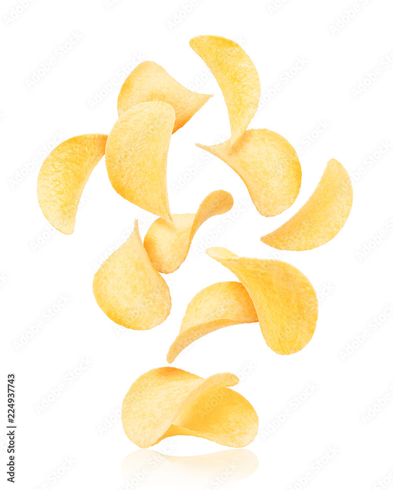 Fototapeta Potato chips rise up from the pile with chips, isolated on a white background