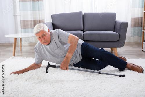 Fototapeta Senior Man Fallen On Carpet obraz