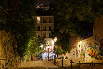 Fototapeta Paris, France - August 22, 2018: Stairs, lights and historical buildings on Montmartre by night
