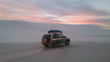 canvas print picture - Off-road vehicle in dry outback of Australia