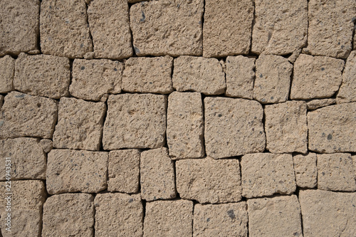 Canvas Print ignimbrite stone wall - natural stone wall background