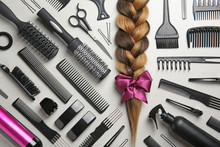 Flat Lay Composition With Braid And Hairdresser's Tools On Gray Background