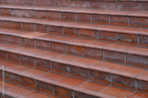 Fotobehang Trappen stairs, terracotta tiles - terracotta tiled stairway closeup