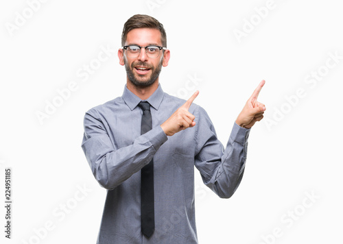 Deurstickers Ontspanning Young handsome business man over isolated background smiling and looking at the camera pointing with two hands and fingers to the side.