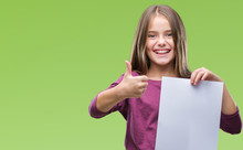 Young Beautiful Girl Holding Blank Sheet Paper Over Isolated Background Happy With Big Smile Doing Ok Sign, Thumb Up With Fingers, Excellent Sign