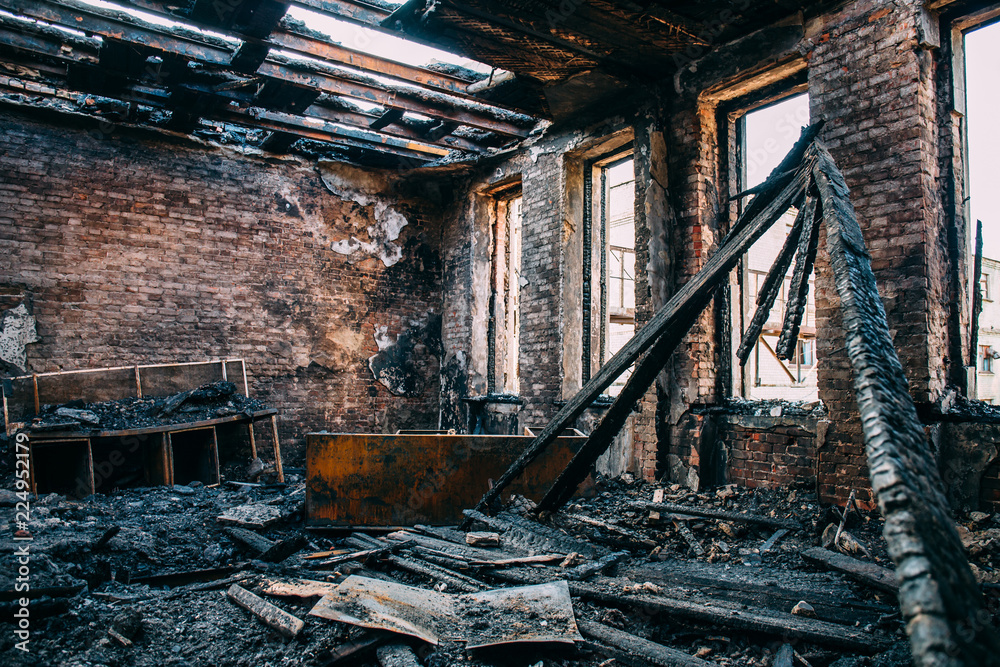 Fototapeta Burnt room interior with walls, furniture and floor in ash and coal, ruined building after fire