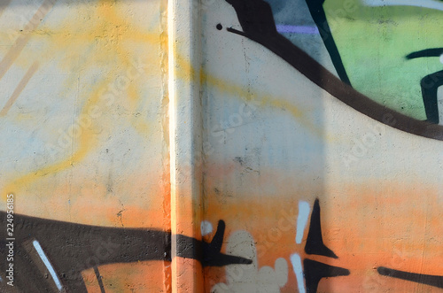 Foto op Canvas Weg in bos Fragment of graffiti drawings. The old wall decorated with paint stains in the style of street art culture. Colored background texture in warm tones