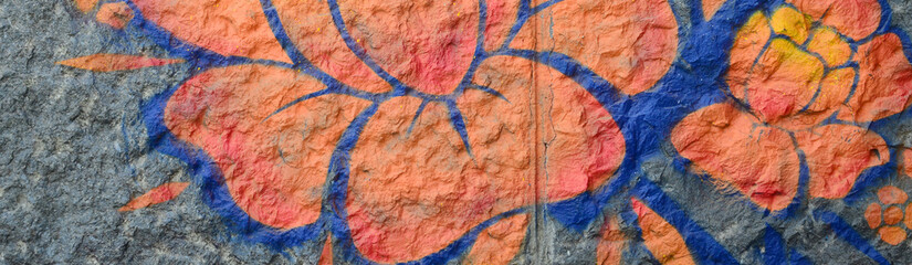 Fragment of graffiti drawings. The old wall decorated with paint stains in th...