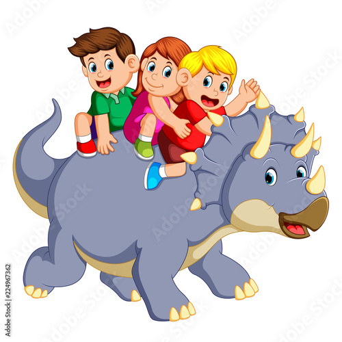 Photo the children are sitting on the triceratops and waving their hand when it move