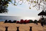 Fototapeta Do akwarium - odpoczynek na plaży przy zachodzie słońca