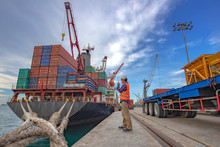 The Loading And Discharging Operation Container Ship Vessel In Port Takes Control By Stevedore And Foreman In Charge, Working In Port Terminal Being For Logistics And Transport Services To Worldwide.