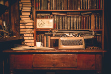 An Old Typewriter Is On The Table.writer's Room.old Books Are On The Shelves.Vintage Room Of The Researcher, Critic, Scientist,
