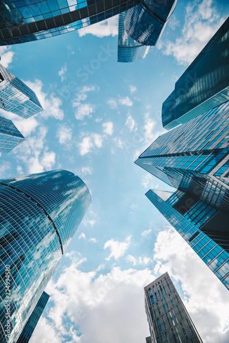 Spoed Foto op Canvas Stad gebouw skyscrapers/ High buildings of skyscrapers in blue tones on the sky background
