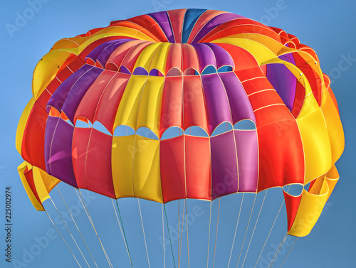 Foto op Canvas Luchtsport Flying colorful, beautiful parachute in the air.