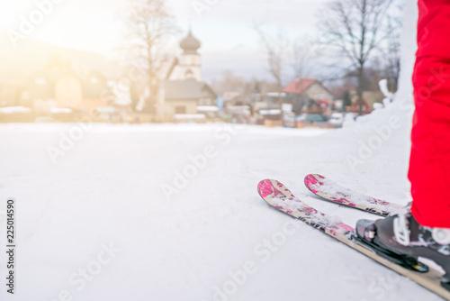 Little girl preparing to ski downhill