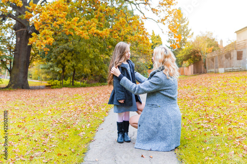 Mother and daughter at park in autumn in London Canvas Print