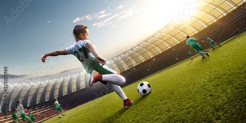 Tuinposter Voetbal children soccer player in action in stadium