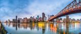 Fototapeta Nowy Jork - New York, New York, USA skyline of Manhattan from across the East River with Queensboro Bridge at dusk.
