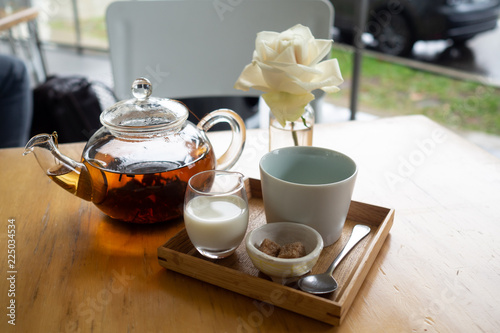 Foto op Aluminium Assortiment White rose next to fancy tea pot