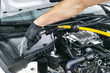 Car detailing maintenance, cleaning engine with hot steam. High pressure washing. Car washing concept. Car detailing. A man cleaning car. Worker cleaning. Cleaning engine with the foam and a brush