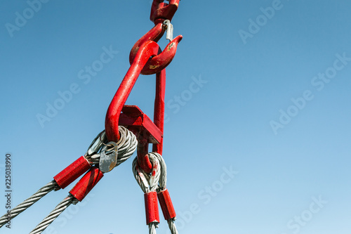 hook of a crane lifts a load on the background of blue sky Fototapet