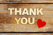 Thank You Written With Wooden Letters And One Red Heart