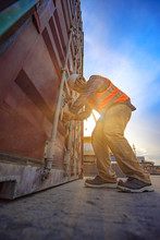 Foreman Worker Labor Or Stvedore Works On Checking Safety And Sealing Door Of Containers Unit, Safety Before Shifting To The Ship, Loading Shipment Security